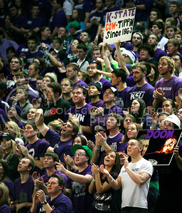 Up front of the packed student section Alan Heide (can't find online), Monty Thompson, Senior in Mass Communication, and Michael Pereira, junior in Mass Communication passionately cheer for the Wildcats in Thursday's game against Texas in Bramlage Coliseum.