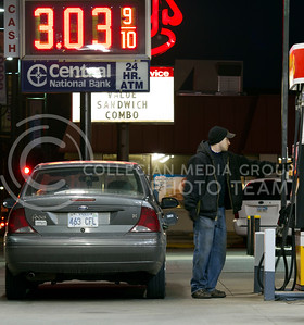Kris Singer, from Manhattan, fills up at the Shell gas station Tuesday night. Although the prices have been steadly rising, people continue to fill up on the current price.  (Photo by Evert Nelson/Collegian)