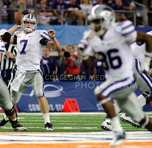 Wildcat quarterback Collin Klein drops back to pass during the 2012 Cotton Bowl in Cowboys Stadium. Klein threw for 173 yards and rushed for 42 more, but it was not enough as K-State lost to Arkansas, 29-16.