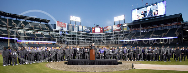 K-State head coach Bill Snyder speaks to a large crowd at Rangers Stadium with his team behind him during the Wildcats pep rally the night before the Cotton Bowl. Snyder said that he expected to see such a large amount of supporters for the bowl game.