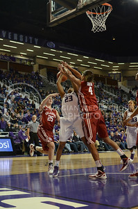 Ashia Woods, freshman guard, gets the ball knocked out of her hands as she goes for a basket during the Oklahoma University game Jan. 17 in Bramlage.