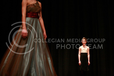 Mallorie Reimer, a Wildcat Princess, gazes after a mentor during the evening gown competition Sunday afternoon. The Miss K-State participants mentored a set of girls as a part of the competition guidelines.