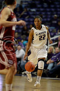 Mariah White, junior guard, dribbles up court during the OU game in Bramlage Jan. 17.