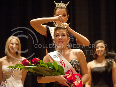 Miss Kansas 2011, Carissa Kelly, crowns Miss K-State Wildcat 2012, Danielle Hill. Two participants were crowned titles at the pagent Sunday- Miss K-State Wildcat and Miss Manhattan.