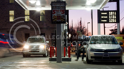 Although gas prices continue to rise, people still manage to fill up at Kwik Shop on the current prices in Manhattan.  (Photo by Evert Nelson/Collegian)