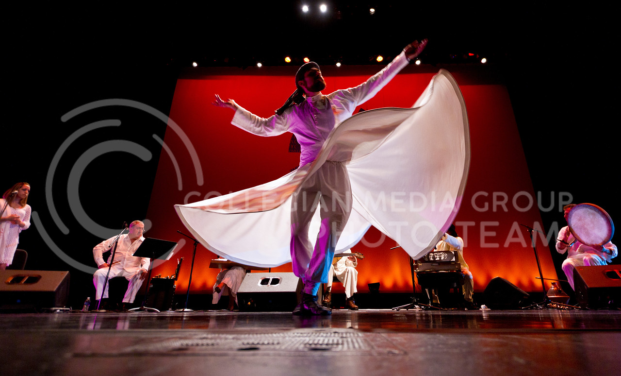 A Sufi whiler dances while the Yuval Ron Ensemble playes mystical music from the Middle East in the background. The concert was held at McCain Auditorium Thursday night.<br /> <br /> (Photo by Evert Nelson/Collegian)