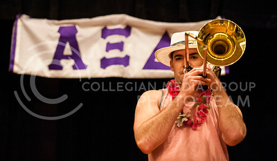 (Photo by Hannah Hunsinger | Collegian) The contestant of Tau Kappa Epsilon plays the latin jazz on his trombone during the talent portion of the Xi Man talent show, put on by the ladies of Alpha Xi Delta for benefit their philanthropy Autism Speaks in the Union Ballroom on Thursday, April 18, 2013.