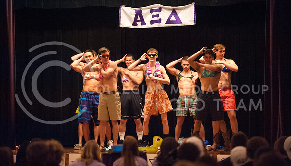 (Photo by Hannah Hunsinger | Collegian)  The contestants of the Xi Man talent show open with a group dance which received enthusiastic cheering.  The talent show was put on by the ladies of Alpha Xi Delta for benefit their philanthropy Autism Speaks in the Union Ballroom on Thursday, April 18, 2013.