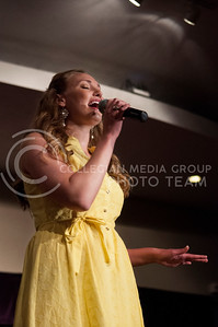 (photo by Hannah Hunsinger   Collegian) Lauren Dunkak, representing Alpha of Clovie, performs Corrine Bailey Rae's 'Put Your Records On' for her talent in the Delta Upsilon Miss K-State Compeition on April 23, in the KSU Ballroom in the Union.