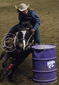 Sage Henderson, senior in animal sciences and industry, competes in the Barrel Racing portion of the 57th Annual Kansas State University Rodeo held on February 22nd in Weber Arena. [Jacob Dean Wilson | Collegian]