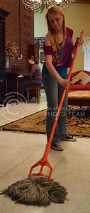 (Photo by Parker Robb | Collegian)  Ashley Stewart, sophomore in agronomy, mops the floor of Clovia's living room April 15, 2013. Other house jobs at Clovia include cooking, dishes, cleaning, and yard work, among others duties.