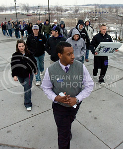 Adrian Esquilin, sophomore in open option, leads a group of students into Bramlege Coliseum before the game against Texas Tech Febuary 25. Student generally start to line up outside on the East side of Bill Snyder Family Stadium up to three hours depending on the game to get first choice on seats.  (Photo by Evert Nelson | Collegian)
