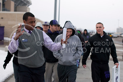 (4:25) Adrian Esquilin jokes with students outside of Bill Snyder Family Stadium while leading them into Bramlege Coliseum. The students who, who had arrived early for the K-State vs. Texas Tech game, line up outside of the East gates to the stadium before being allowed to come up.  (Photo by Evert Nelson | Collegian)
