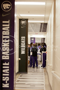 The men's basketball team gets ready for their game against Texas Tech by dancing in front of the camera which is displayed on the center screens at Bramlage Coliseum.  (Photo by Evert Nelson | Collegian)