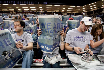 "Wildcat fans prepare for the basketball game against Texas Tech by holding up newspapers with ""We Are K-State PROUD"" on them at Bramlage Coliseum. The newspaper tradition has been going on for years although it makes quite a mess for the Bramlage staff.  (Photo by Evert Nelson 