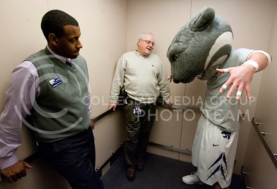 (5:02)  Sharing an elevator with Willie the Wildcat and Jim Muller, Adrian Esquilin mocks our schools mascot by making fun of his cat like features. Esquilin was on his way to the offices to check on his staff before the game against Texas Tech.  (Photo by Evert Nelson | Collegian)