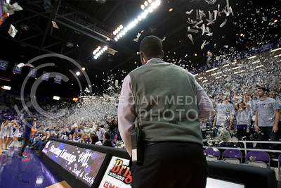 Adrian Esquilin anticipates falling newspaper onto the floor of Bramlage Coliseum before the game against Texas Tech.  (Photo by Evert Nelson | Collegian)