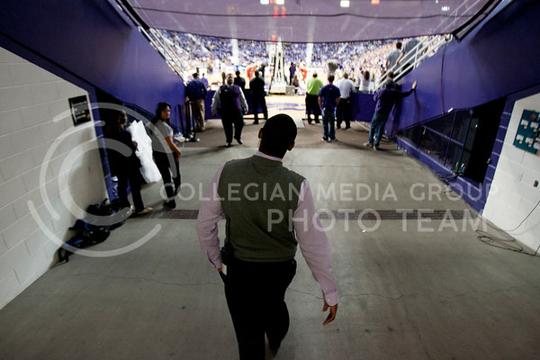 Walking out of the tunnle into the center of Bramlege Coliseum, Adrian Esquilin, begins to check on his staff just before half time.  (Photo by Evert Nelson | Collegian)