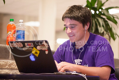 "Working in the Student Union Thursday night, Zach Kurth, freshman in enterprise, sets up his laptop and studying materials outside of the foodcourt. ""I like that it's 24 hours now, I'm probably the only person here,"" Kurth said about studying in the union.  (Photo by Evert Nelson 