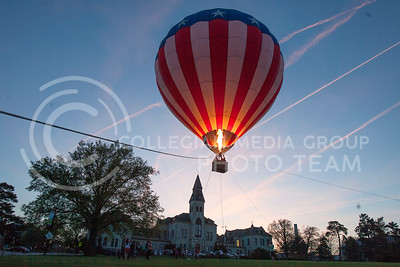 A hot air balloon glows as it rises over Anderson lawn Monday night. Students lined in front of the hall to get a chance to ride the balloon, which was put on by UPC.  (Photo by Evert Nelson | Collegian)