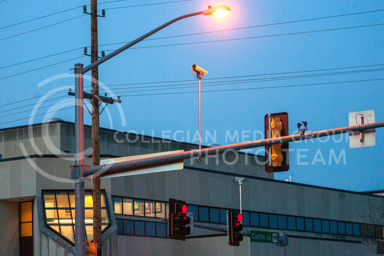 A streetlight illuminates a camera mounted above Clafin Rd and Denison Ave. Tuesday night. Although popular belief, these cameras are not used to catch those running red lights. <br /> <br /> (Photo by Evert Nelson | Collegian)