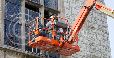 Russell Edem | Collegian A consruction crew works on the windows on the back of Hale library Tueday afternoon.