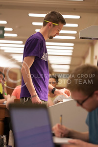 Ben Raaf, senior in music education, copies pages using a scanner on the 4th floor of Hale Library Thursday night. Raaf was scanning singing song music for K-6 grade students.  (Photo by Evert Nelson | Collegian)
