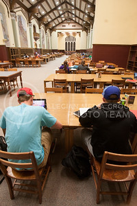Working along other students in the Great Room, Steven Starr (bottom left), freshman in architecture, studies with RJ Pericola (bottom right), freshman in marketing entrepreneur, Thursday night.   (Photo by Evert Nelson | Collegian)