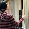 (Photo by Parker Robb | Collegian)  Stephen Christenberry, freshman in architecture, looks for a piece of matte board for an architecture project Wednesday afternoon in the Union Bookstore in the K-State Student Union.