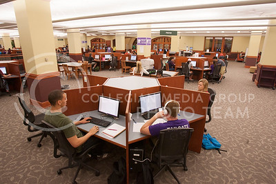 Students in Hale Library Thursday night gather around computer modules to work on various assingments. Utilizing the libraries utlities is a way of keeping up with the amout of work associated with taking university classes.   (Photo by Evert Nelson | Collegian)