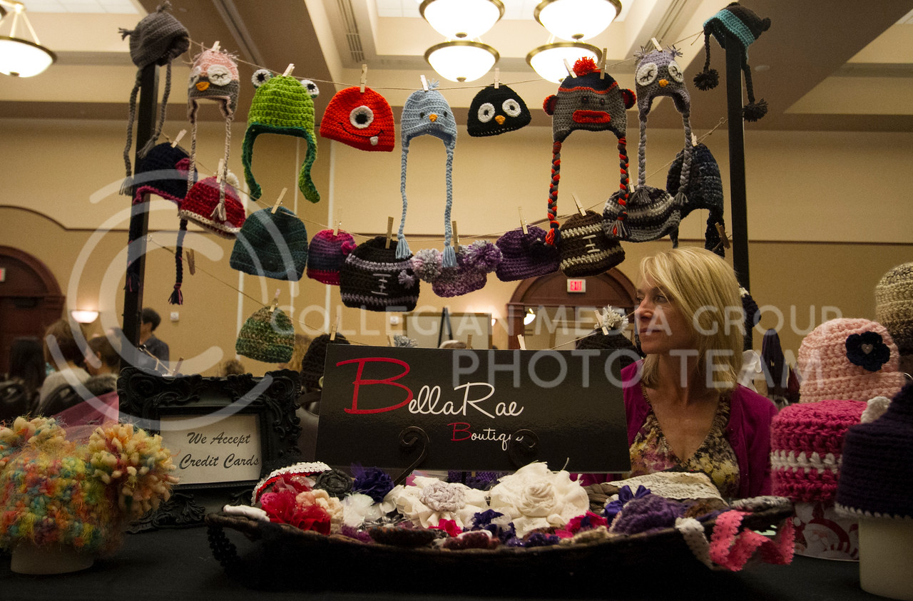Mignon Brown, Manhattan resident, watches the Quarter Auction from the BellaRae Boutique booth set up in the Ballroom of the Alumni Center Monday night. This booth was one of about 40 at the Womens Preview and Fashion Show as part of the RSVP of the Flint Hills Festival of Trees.<br /> <br /> (Photo by Evert Nelson/Collegian)