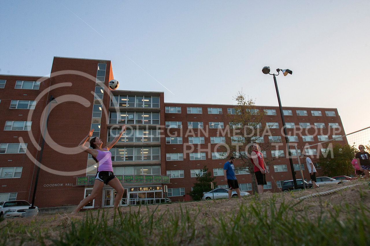 Kirsty Wray, freshman in pre-nursing, sets up to serve a volleyball to an opposing side outside of Goodnow Hall Tuesday night. Wray joined other students in enjoying the warm spring weather outside.<br /> <br /> (Photo by Evert Nelson | Collegian)