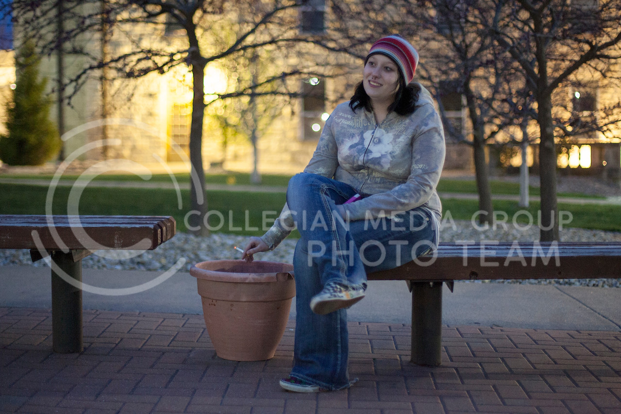 Sitting outside of Boyd and Van Zile Halls, Megan Weatherred, freshman studying social work, takes a moment to sit and smoke.<br /> <br /> (Photo by Evert Nelson | Collegian)