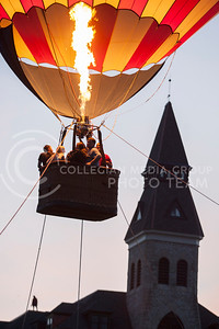 Students take rides on a hot air balloon in front of Anderson Hall Monday night as Hannah Hunsinger covers the event front the top of Anderson Hall. The balloon rides were put on by UPC.  (Photo by Evert Nelson | Collegian)