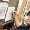 Yusheng Zhou, a freshman in open option, works on his drawing exercise in Willard Hall on January 31. Many other art students were working on their art projects.
