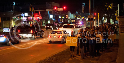 (Photo by Hannah Hunsinger | Collegian)   The participants of the Take Back the Night march walk up Manhattan Ave. from Aggieville while chanting anti-violence against women slogans on the night of April 4, 2013.