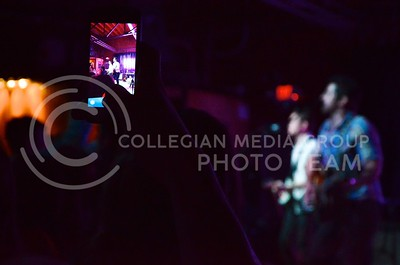 (Photo by Parker Robb | Collegian)  A fan of country musician JT Hodges takes a photo of him performing with her smartphone during Hodges' performance at Aggieville Central Station May 4, 2013.