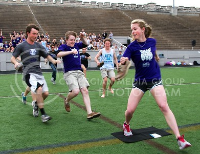 (Photo by Jed Barker | Collegian) Karsen Brown, junior in Animal Science, beats the guys back to the mat to score for the purple team in a game called Greek Quest during the Greek Olympics at Old Stadium on Monday, April 8, 2013.