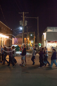 Supporters for Take The Night, an event against women violence, march through Aggieville Thursday night chanting to gain more support.  (Photo by Evert Nelson | Collegian)