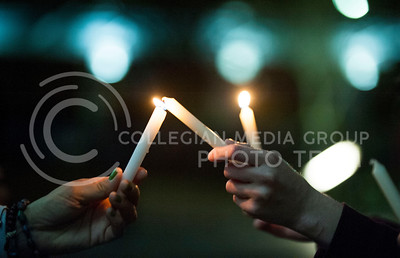 (Photo by Hannah Hunsinger | Collegian)   After the Take Back the Night march participants gathered in Bosco Plaza to light candles and listen to live music on April 4, 2013.