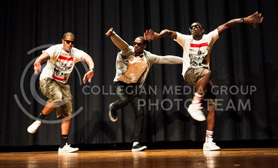 (Photo by Hannah Hunsinger | Collegian)   Samuel Yeboah, center, sophomore in business administration and marketing, dances with friends at the Blue Apolle Talent show in Forum Hall on Friday, Aprili 12, 2013.  Yeboah, an international student from Britian, won the talent show.