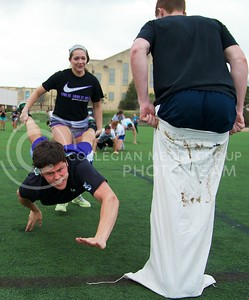 (Photo by Jed Barker   Collegian) Tim Turner, freshman in kinesiology, lunges for the line as his partner, McKenzie Benoit, freshman in pre-journalism & mass communication, tries to keep his feet up during the wheel barrow leg of a relay race, which was the final event of the Greek Olympics at the Old Stadium on Monday, April 8, 2013.