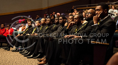 (Photo by Hannah Hunsinger | Collegian)   The men of Alpha Phi Alpha listen to reowned speaker Michael Eric Dyson as he speaks about minorities liftly up other minorities (or something like that) in Forum Hall on the evening of April 24, 2013.  Dyson is a minister turned college professor, who roams the country speaking on everything from culture criticism, to religion and gender studies and curently teaches at Georgetown University.