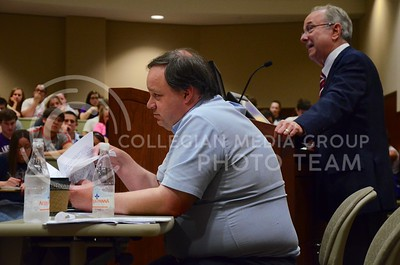 (Photo by Parker Robb | Collegian)  Brad Delong, professor of economics at Cal-Berkley, looks over his notes while Alan Reynolds gives his proposed solution to America's current fiscal crisis during their economics debate in the Leadership Studies Building April 30, 2013.
