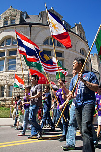 (Photo by Jed Barker | Collegian) The K-State International Week activities began with a parade and an afternoon of games on April 6, 2013.  With flags held high, international student groups paraded down Mid-Campus Drive, walking from the International Student Center to the Student Union, while singing their respective national anthems.