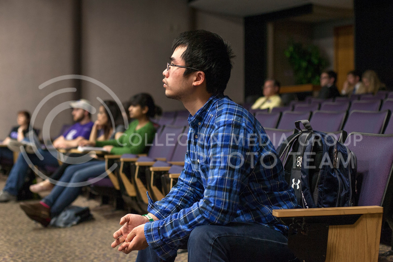 Jianlong Lin, freshman international student, listens to the open forum in Little Theater Thursday. The open forum was over a discussion on the proposed design for the Student Union.<br /> <br /> (Photo by Evert Nelson | Collegian)