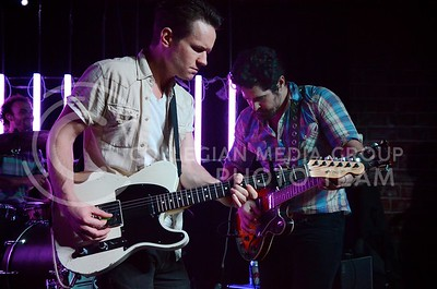 (Photo by Parker Robb | Collegian)  Country musician JT Hodges (right) plays an opening guitar riff with his electric guitarist during his performance at Aggieville Central Station May 4, 2013.