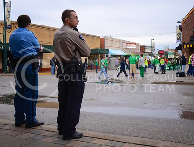 (Photo by Parker Robb | Collegian)  Law enforcement officers observe Fake Patty's Day revelers coming and going March 9 in Aggieville.