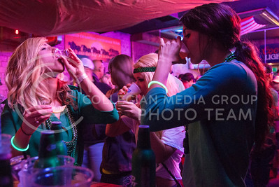 (Photo by Hannah Hunsinger | Collegian)  A trio of girls do shots in a bar in Aggieville on Saturday, March 9, 2013.