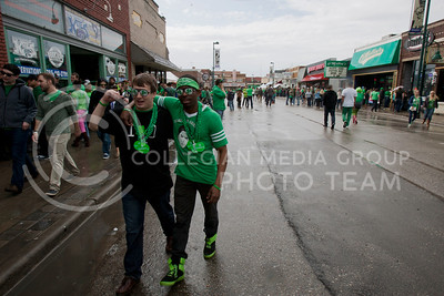 "People decked out in green flooded Moro Street Saturday for the legendary ""Fake Patty's Day"" event. From early in the morning to late into the night, people took part in the activities the day brought on.  (Photo by Evert Nelson 